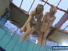 Horny girls strip eachother in the pool Thumb