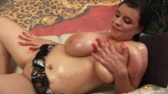 Milf shows her oiled monster boobs Thumb