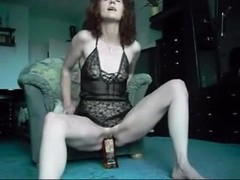 Redhead mature bottle show Thumb