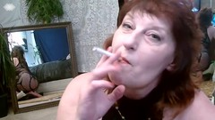 V 334 Curvy Mature Dawn smokes and then fingers to juicy orgasm Thumb